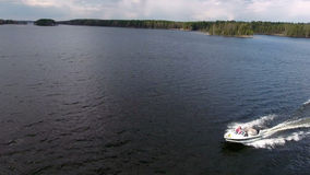 Side view of small powerboat riding in big lake, aerial view from drone, copyspace Stock Image
