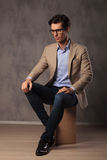 Side view of a smart casual man sitting Stock Image