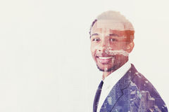 Side view of smiling African businessman and city Stock Photos