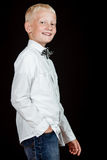 Side view of smiling boy wearing white shirt Royalty Free Stock Photos