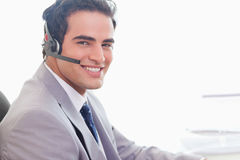 Side view of smiling businessman with headset on Royalty Free Stock Photography