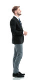 Side view of a smiling businessman standing , On white backgroun Royalty Free Stock Images