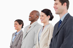 Side view of smiling businessteam standing together Stock Photos