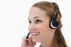 Side view of smiling call center agent Stock Images