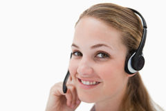 Side view of smiling call center agent with headset Royalty Free Stock Photography
