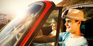 Side view of smiling couple on their way to beach Stock Photos