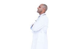 Side view of smiling doctor with arms crossed Royalty Free Stock Photo