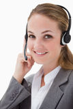 Side view of smiling female call center agent Stock Images