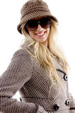 Side view of smiling female wearing overcoat Royalty Free Stock Photography