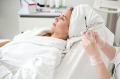 Glad lady during treatment procedure stock photography