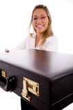 Side view of smiling lawyer showing briefcase Royalty Free Stock Images