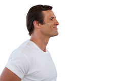 Side view of smiling mature man looking away. Against white background Royalty Free Stock Image