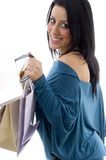 Side view of smiling model carrying carry bags Stock Images