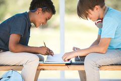 Multiethnic boys studying together Royalty Free Stock Images
