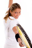 Side view of smiling tennis player with racket Royalty Free Stock Photos
