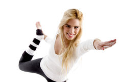 Side view of smiling woman doing exercise Royalty Free Stock Image