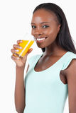 Side view of smiling woman with orange juice Royalty Free Stock Images
