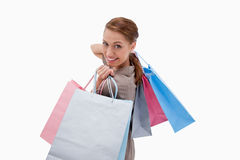 Side view of smiling woman with shopping bags Royalty Free Stock Photos