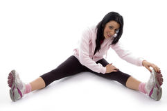 Side view of smiling woman stretching her legs Royalty Free Stock Photos