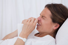 Side view of sneezing woman Royalty Free Stock Images