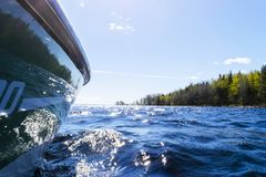 Speeding fishing motor boat with drops of water. Blue ocean sea water wave reflections with fast fishing yacht. Motor boat in the. Blue ocean. Ocean yacht stock photo