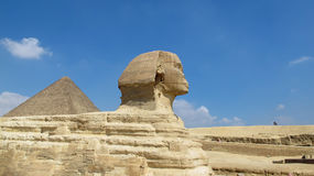 Side view Sphinx and great pyramid Stock Images