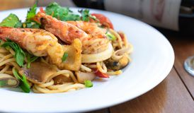 Side view spicy spaghetti stirfried seafood thai food, tum yum talay. Close up side view spicy spaghetti stirfried seafood thai food, tum yum talay royalty free stock photography