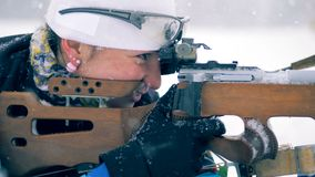 Side view of a sportswoman shooting and reloading the rifle. 4K stock video