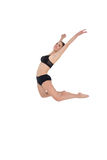 Side view of a sporty woman jumping on white background Royalty Free Stock Photos