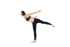 Side view of a sporty woman stretching Royalty Free Stock Images