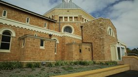 Cathedral Geraldton WA. Side view of St. Francis Xavier`s Cathedral with dome or Geraldton Cathedral on Cathedral Ave, is the main place of Catholic worship in stock video