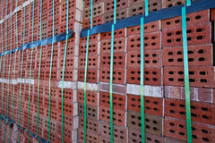 Side view of stack of bricks. Stack of bricks in manufacturing brickyard Stock Image