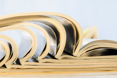 Side view of a stack of magazines Royalty Free Stock Images