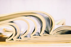 Side view of a stack of magazines Stock Photos