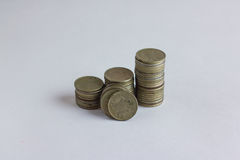 Side view of stacks of coins increasing in height, on white studio background. Side view of stacks of Russian coins increasing in height, on white studio Stock Image