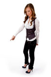 Side view of standing woman pointing Stock Photos