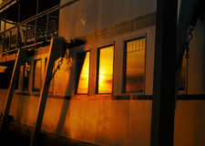 Side View of a Steamship Bathed in Sunset Glow Royalty Free Stock Images