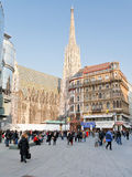 Side view of Stephansdom in Vienna. VIENNA - MARCH 9: tourists near Stephansdom on Stephansplatz in Vienna, Austria on March 9, 2011. Stephansplatz is a square Royalty Free Stock Images