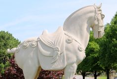 Side View of a stone war horse statue in full show regalia. Royalty Free Stock Photos