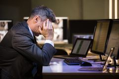 Stressed Businessman Sitting In Office royalty free stock photo
