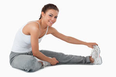 Side view of stretching woman Royalty Free Stock Images