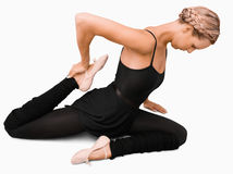 Side view of stretching woman. Against a white background Stock Photos