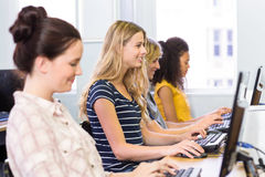 Side view of students in computer class Stock Photo