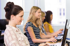 Side view of students in computer class Royalty Free Stock Image