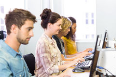 Side view of students in computer class Royalty Free Stock Photos