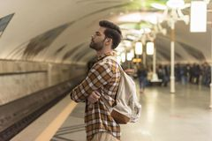 Side view of stylish man. With closed eyes waiting train at subway station royalty free stock image