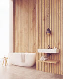 Side view of sunlit bathroom with sink Royalty Free Stock Images