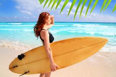 Side view surfer woman tropical sea looking waves. Surfer woman side view tropical sea looking waves Caribbean sea Royalty Free Stock Images