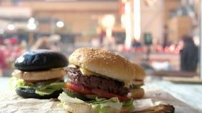 Side view of tasty burgers. Sesame bun cheeseburger. Best fast food deals stock footage