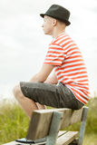 Side view of teen sitting on bench Royalty Free Stock Photography